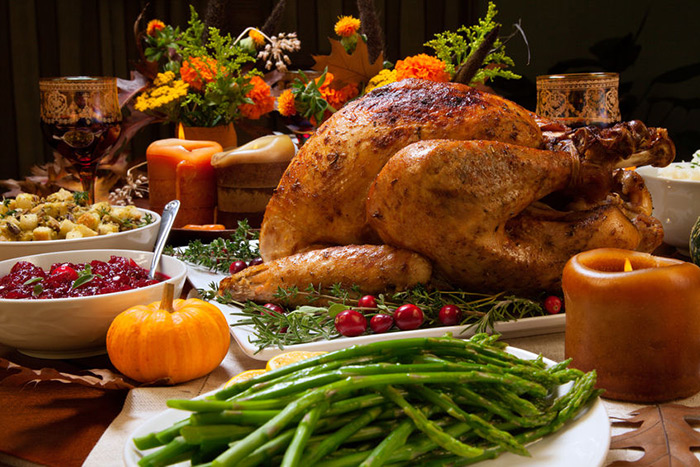 It's not impossible to save money hosting Thanksgiving dinner.